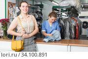 Купить «Satisfied client of dry cleaner», фото № 34100891, снято 9 мая 2018 г. (c) Яков Филимонов / Фотобанк Лори