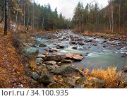 Купить «Water autumn landscape. A shallow fast mountain river with a rocky bottom. Ural.», фото № 34100935, снято 29 июня 2020 г. (c) Акиньшин Владимир / Фотобанк Лори