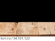 Купить «Wooden table on a black background can used for display or montage your products.», фото № 34101123, снято 11 июня 2020 г. (c) Ярослав Данильченко / Фотобанк Лори