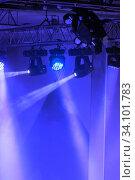 Купить «Spotlights and laser beams. Concert light. Stage lights. Soffits», фото № 34101783, снято 16 февраля 2018 г. (c) Евгений Ткачёв / Фотобанк Лори