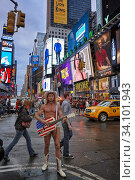 Купить «Robert Burck, better known as the Naked Cowboy performing at Times Square at dusk. Manhattan, New York City, USA.», фото № 34101943, снято 30 июня 2020 г. (c) age Fotostock / Фотобанк Лори