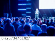 Купить «Crowd of seated business people in the background of the presenter on stage. Defocused blurred picture for background.», фото № 34103827, снято 3 июля 2020 г. (c) age Fotostock / Фотобанк Лори
