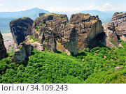 Meteora rocks with Orthodox Christian monastery near Kalambaka town, Greece. Стоковое фото, фотограф Zoonar.com/Serghei Starus / easy Fotostock / Фотобанк Лори