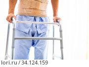 Closeup of elderly using adult walker in hospital. Стоковое фото, фотограф Zoonar.com/Vichaya Kiatying-Angsulee / easy Fotostock / Фотобанк Лори