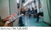 Купить «Entertainment with pad during underground travel», фото № 34126643, снято 14 июля 2020 г. (c) Данил Руденко / Фотобанк Лори