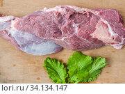 Купить «A piece of raw beef and a lettuce leaf on the table», фото № 34134147, снято 26 мая 2020 г. (c) Катерина Белякина / Фотобанк Лори