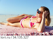 Купить «Beautiful woman sunbathing on the beach», фото № 34135327, снято 25 февраля 2020 г. (c) Wavebreak Media / Фотобанк Лори