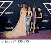 Elizabeth Banks, Ella Balinska, Kristen Stewart and Naomi Scott at the Los Angeles premiere of 'Charlie's Angels' held at the Regency Village Theater in Westwood, USA on November 11, 2019. Стоковое фото, фотограф Zoonar.com/Lumeimages.com / age Fotostock / Фотобанк Лори