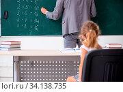 Купить «The teacher with young girl in the classroom», фото № 34138735, снято 3 июля 2020 г. (c) easy Fotostock / Фотобанк Лори