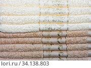 Купить «Big pile of beige and brown bath towels», фото № 34138803, снято 6 июля 2020 г. (c) easy Fotostock / Фотобанк Лори