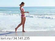 Купить «Beautiful woman walking on the beach», фото № 34141235, снято 25 февраля 2020 г. (c) Wavebreak Media / Фотобанк Лори