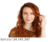 Middle age red-haired woman smiles at the camera over white. Стоковое фото, фотограф Алексей Кузнецов / Фотобанк Лори