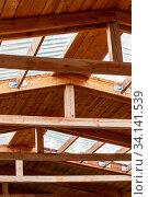 Купить «Double roof rafters. Construction of second floor inside», фото № 34141539, снято 23 июня 2020 г. (c) Евгений Ткачёв / Фотобанк Лори