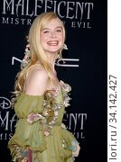 Elle Fanning at the World premiere of Disney's 'Maleficent: Mistress Of Evil' held at the El Capitan Theatre in Hollywood, USA on September 30, 2019. Стоковое фото, фотограф Zoonar.com/Lumeimages.com / age Fotostock / Фотобанк Лори