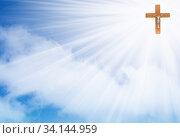 Купить «Wooden cross crucifix in the rays of light on a blue background with cloud», фото № 34144959, снято 7 июля 2020 г. (c) easy Fotostock / Фотобанк Лори