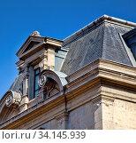 Купить «Lion, France.A Dormer window of classical Hellenic architectural form, volute, Palmetta, Greek pediment», фото № 34145939, снято 13 июля 2020 г. (c) easy Fotostock / Фотобанк Лори