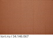 Купить «Close up background pattern texture of brown corrugated packaging cardboard», фото № 34146067, снято 6 июля 2020 г. (c) easy Fotostock / Фотобанк Лори