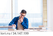 Купить «Student studying in the empty library with book preparing for ex», фото № 34147199, снято 19 января 2018 г. (c) Elnur / Фотобанк Лори