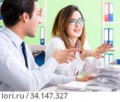 Купить «Two colleagues working in the office», фото № 34147327, снято 11 июня 2018 г. (c) Elnur / Фотобанк Лори