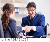 Disabled businessman having discussion with female colleague. Стоковое фото, фотограф Elnur / Фотобанк Лори