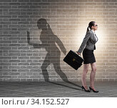 Купить «Businesswoman and his shadow in business concept», фото № 34152527, снято 7 июля 2020 г. (c) Elnur / Фотобанк Лори