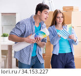 Young family planning home DIY renovation with drawing. Стоковое фото, фотограф Elnur / Фотобанк Лори