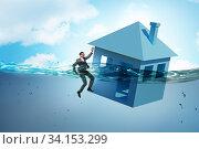 Купить «Mortgage repayment failure concept with man», фото № 34153299, снято 10 июля 2020 г. (c) Elnur / Фотобанк Лори