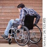 Купить «Disabled man on wheelchair having trouble with stairs», фото № 34153495, снято 14 апреля 2017 г. (c) Elnur / Фотобанк Лори