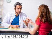 Female diabetic patient visiting young male doctor. Стоковое фото, фотограф Elnur / Фотобанк Лори