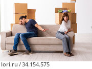 Купить «Young pair and many boxes in divorce settlement concept», фото № 34154575, снято 3 сентября 2019 г. (c) Elnur / Фотобанк Лори