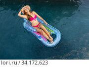 Купить «Young woman relaxing in the swimming pool», фото № 34172623, снято 28 ноября 2019 г. (c) Wavebreak Media / Фотобанк Лори