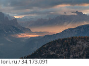 Sunrise light from Passo Giau, with fog in the Cortina valley, Dolomites, Italy, October 2019. Стоковое фото, фотограф John Shaw / Nature Picture Library / Фотобанк Лори