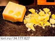 Купить «Parmesan cheese on black stone plate in buffet line», фото № 34177827, снято 9 июля 2020 г. (c) easy Fotostock / Фотобанк Лори