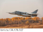Military jet bomber Su-24 Fencer flying above ground. Стоковое фото, фотограф Zoonar.com/Alexander Strela / easy Fotostock / Фотобанк Лори