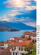 Image of hillside red tiled rooftop houses on the shore of Lake Ohrid, Northern Macedonia. Стоковое фото, фотограф Zoonar.com/Pawel Opaska / easy Fotostock / Фотобанк Лори