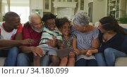 Three generation family using digital tablet at home. Стоковое видео, агентство Wavebreak Media / Фотобанк Лори