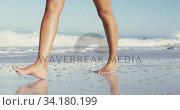 Купить «African American woman walking seaside», видеоролик № 34180199, снято 25 февраля 2020 г. (c) Wavebreak Media / Фотобанк Лори