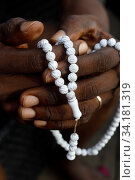 African muslim man praying. Islamic prayer beads (tasbih). Close-up on hands. Togo. Стоковое фото, фотограф Pascal Deloche / Godong / age Fotostock / Фотобанк Лори