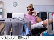 Купить «Young male employee preparing for the trip», фото № 34186759, снято 28 мая 2020 г. (c) Elnur / Фотобанк Лори