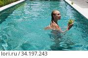Купить «Attractive womanr in the pool with cocktail in coconut», фото № 34197243, снято 26 октября 2016 г. (c) Куликов Константин / Фотобанк Лори