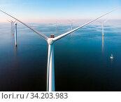 Wind turbine from aerial view, Drone view at windpark westermeerdijk a windmill farm in the lake IJsselmeer the biggest in the Netherlands,Sustainable development, renewable energy, drone view. Стоковое фото, фотограф Zoonar.com/Fokke Baarssen / easy Fotostock / Фотобанк Лори