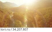 Купить «Low altitude flight over fresh fast mountain river with rocks at sunny summer morning.», видеоролик № 34207807, снято 5 апреля 2019 г. (c) Александр Маркин / Фотобанк Лори