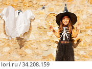 Girl in Halloween witch costume near ghost. Стоковое фото, фотограф Сергей Новиков / Фотобанк Лори