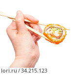 Female hand with disposable chopsticks holds california ebi sushi roll isolated on white background. Стоковое фото, фотограф Zoonar.com/Valery Voennyy / easy Fotostock / Фотобанк Лори