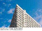 Купить «Angle of the Skyscraper on the Cloudy Sky Background.», фото № 34225051, снято 15 июля 2020 г. (c) easy Fotostock / Фотобанк Лори