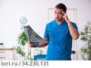 Young male doctor radiologist working in the clinic. Стоковое фото, фотограф Elnur / Фотобанк Лори