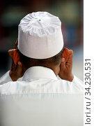 Muezzin. Kufi hat. Стоковое фото, фотограф Fred de Noyelle / Godong / age Fotostock / Фотобанк Лори