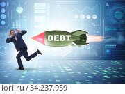Concept of loan and debt with businessman chased by rocket. Стоковое фото, фотограф Elnur / Фотобанк Лори