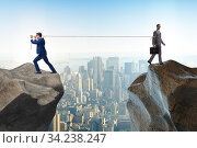 Купить «Boss holding his employee in retention concept», фото № 34238247, снято 3 августа 2020 г. (c) Elnur / Фотобанк Лори