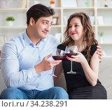 Young pair drinking wine in romantic concept. Стоковое фото, фотограф Elnur / Фотобанк Лори